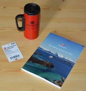 Unverzichtbar: Die Cruise Card, der Becher für den Coffee Deal und das Info-Buch.